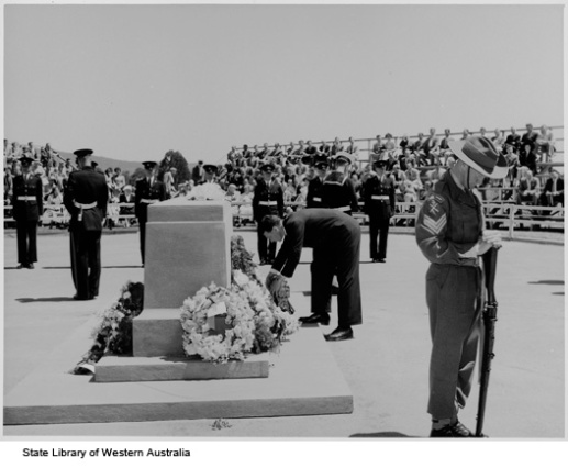 Gordon Reid laying a wreath at Anzac Day ceremony , 1957.