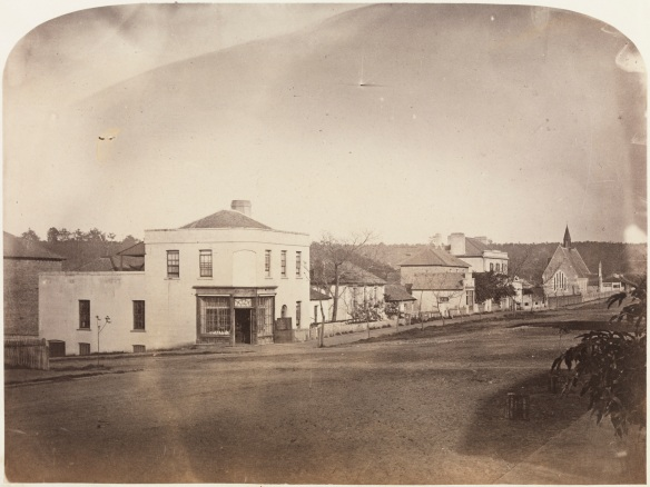 View of St George's Terrace to Perth Boys' School taken from William Street. J. Dyer's store is in the foreground (6923B/106) - appears on page 44 of the album