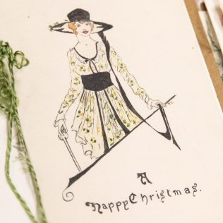Woman in hat. Christmas cards from the Brierley girls, 1920s. Elsey Family papers, ACC 8410A/51
